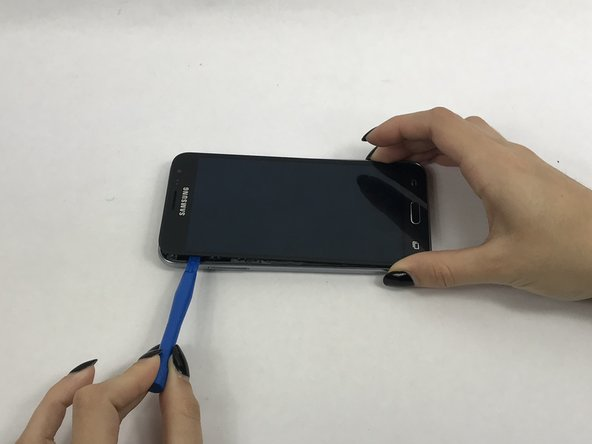 If this is the first time the screen is being removed then there will be adhesive around the edges of the screen. It may be difficult to remove the screen because of this adhesive seal and it is going to take a few tries and some force to pry the entire screen off.