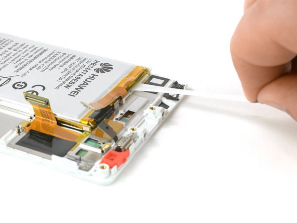 Pull the adhesive tab in a slow constant movement to free the battery.