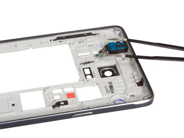 Get the flex free from the adhesive underneath and remove headphone jack naturally.