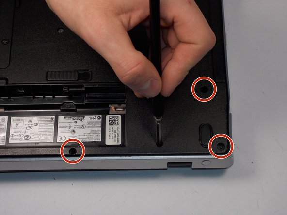 Image 2/2: There are 2 screws to the left of the compartment, 3 to the right, and 2 along the bottom side.