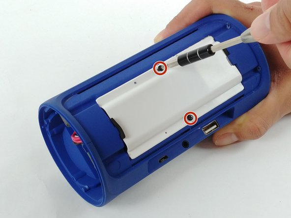 Use a Phillips #1 screwdriver (PH1) to remove the (2) two screws from the battery cover.