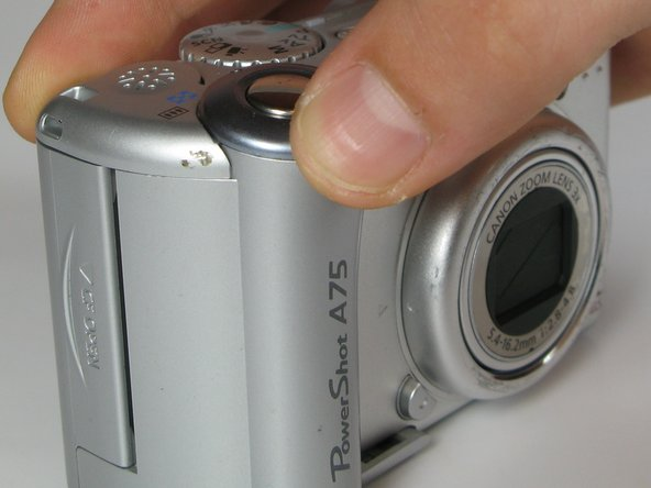 Image 1/2: '''DO NOT''' pull the part too hard because there is a plug connecting the speaker to the camera.