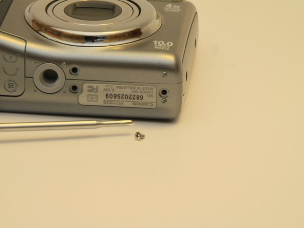 Remove the two coarse thread screws and the single fine thread screw from bottom the camera.