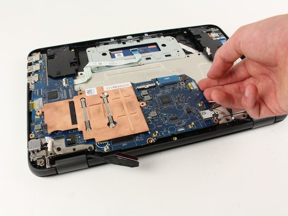 Gently lift and remove the motherboard.
