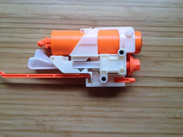 Move the other parts of the Nerf gun away from the air piston and barrel rotator part.