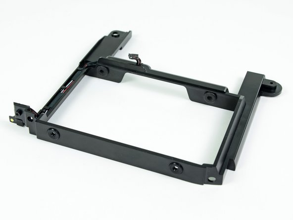 The bracket with all four grommets installed should look like the bracket shown in this picture.