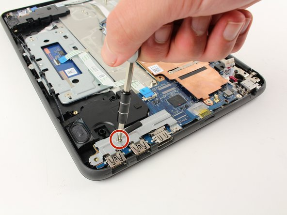 Using a Phillips #0 screwdriver, remove the two 3mm screws.