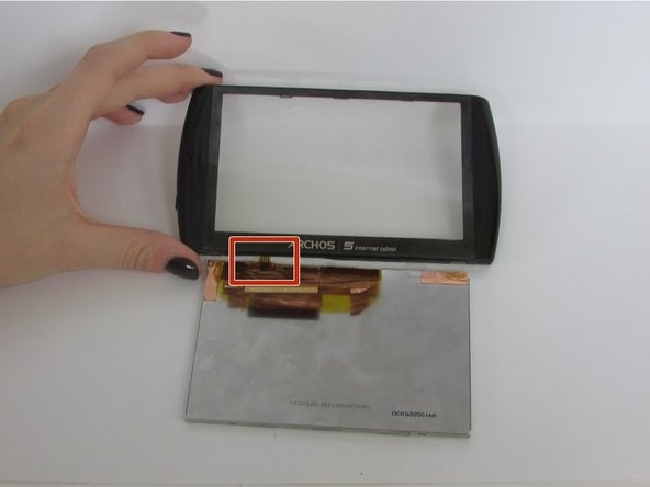 Be careful not to pull or tear the small  film/wires as shown in the picture. These are vital to  connecting the glass screen and  the LCD screen.