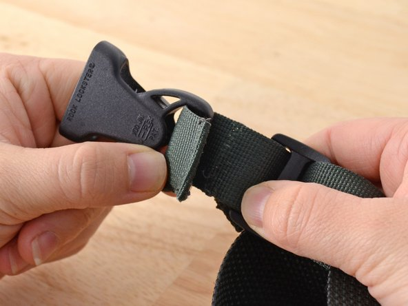 Image 2/2: Align your material. In this case we are resewing the webbing holding a buckle in place.