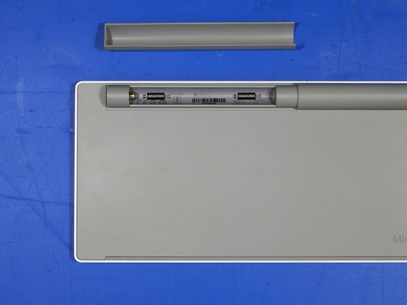 The battery cover is held in place by neodymium magnets and the metalized plastic coating on the cover.