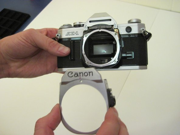 Once the screws have been taken out, you may simply remove the lens casing by pulling it away from the body of the camera.