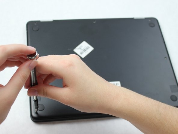 Remove the eight 30 mm screws from the edges of the case with the JIS J000 screw bit.