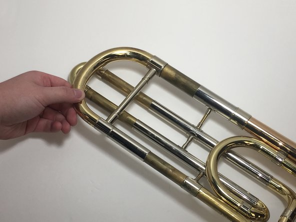 If the slides are completely stuck, wiggle the slides from side to side while pulling it out of the trombone.