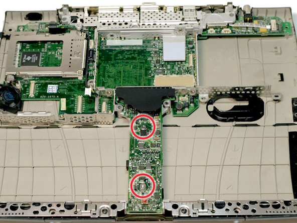 Remove the two long silver Torx screws from the power card in the center of the laptop