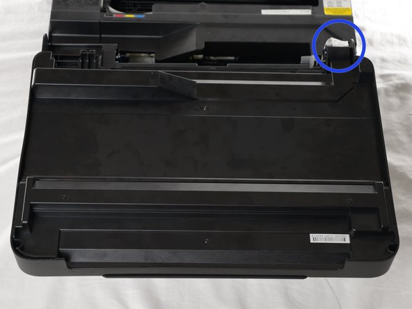 Flip and remove the top of the printer up so that you can see the inside.