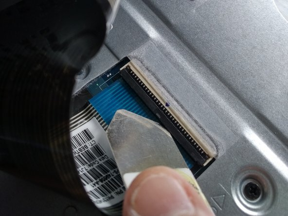 now you will see the very thin ribbon cable attached to a connector.
