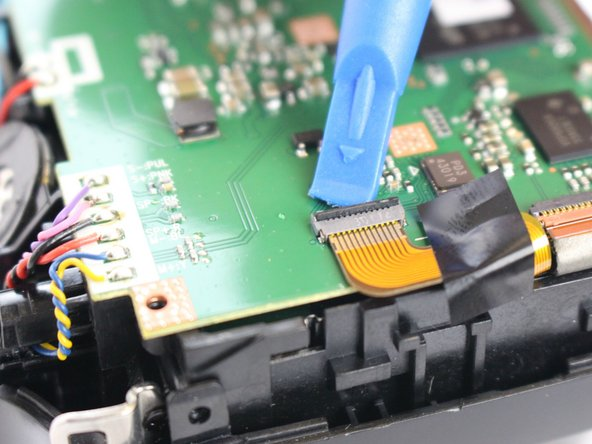 Pull the ZIF cable from motherboard using tweezers.