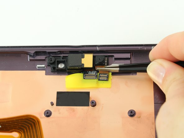 Using tweezers, gently pull the left camera, which is the front facing camera, and small attached ribbon cable off the device and set them aside.