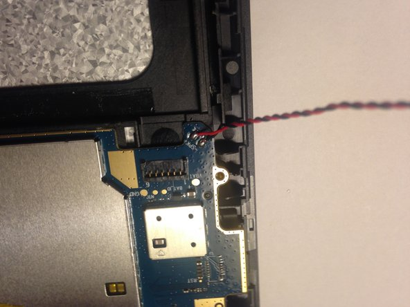 Image 2/3: Set the speaker out of the way. On top of the silver microchip cover on the main pcb is a great place for it.