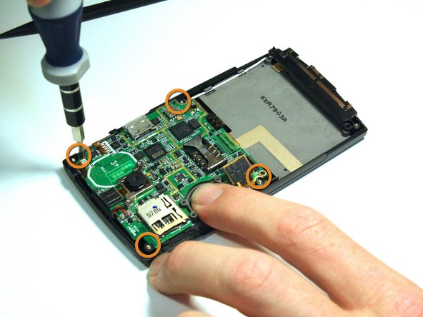 Image 2/2: Use the Phillips 00 screwdriver to remove all of the screws that hold the motherboard in place.