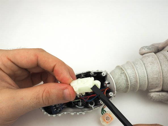 Use a spudger to gently pry apart the assembly for inspection.