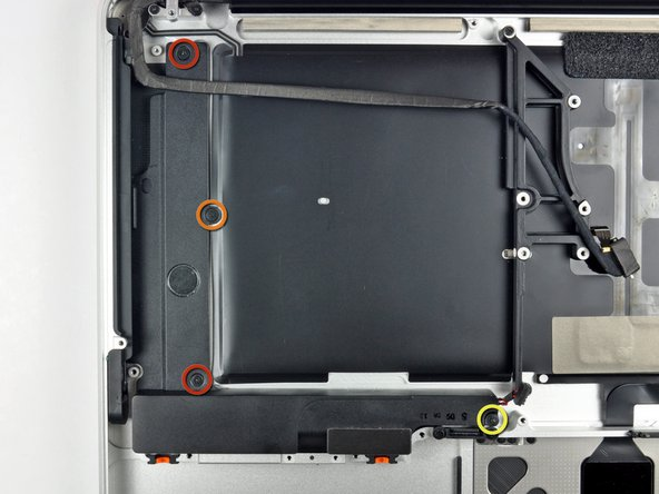 Remove the following four screws securing the subwoofer and right speaker to the upper case: