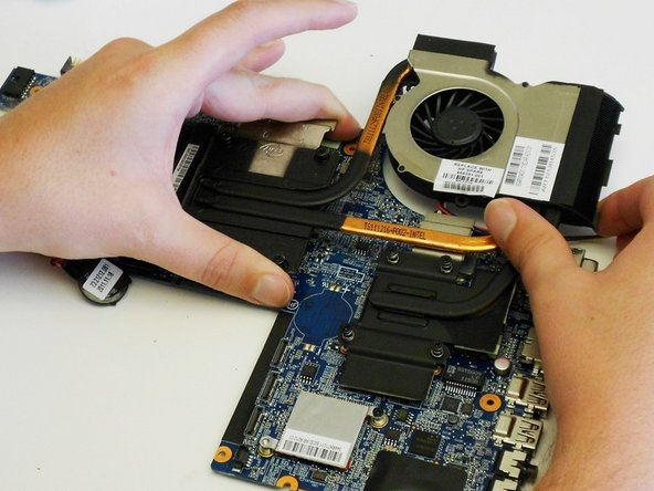 Re-attach the  heat sink assembly to the motherboard.