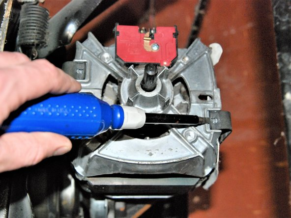 Use the flat head screw driver to pry retaining clips off of motor.