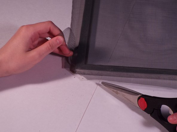 Be careful not to cut too far into the mesh, or it will leave holes in the corners of the screen when it's finished.
