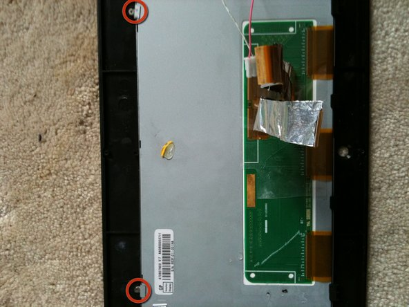 Image 1/2: Remove the screws with a philips 00 screw drives, and remove the two metal brackets holding the LCD to the cheap black frame.