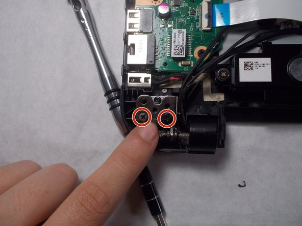 Unscrew the four 6mm screws from each of the laptop hinges using a Philips head #00 screwdriver.