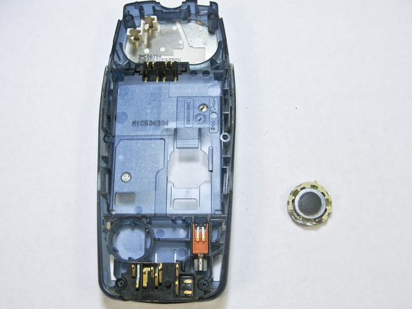 Image 2/3: The microphone is attached to the phone with glue, but removes easily with a spudger.