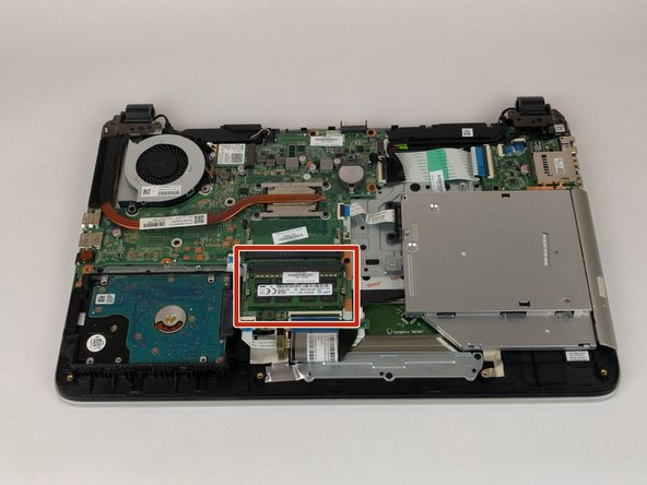 Locate the RAM stick, will be next to hard drive. Unclip the two silver retainers on each side.