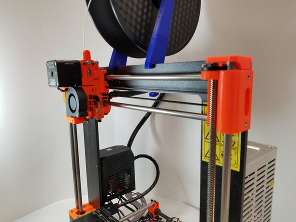 Move the head to the highest position on the Z axis. This provides working room to access the head.