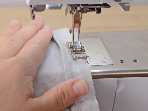 Be sure to only insert one layer of fabric—the hem—or you will sew through the outer, visible layers of the pants.