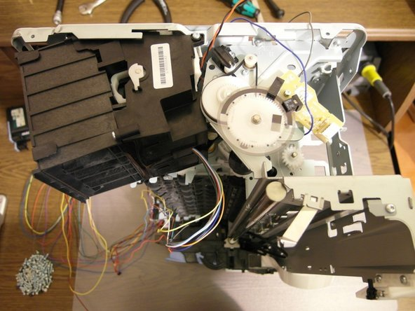 Rotate the printer right to reach the other DC motor.