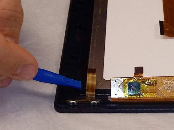 Carefully release the screen from the display using the black tabs.