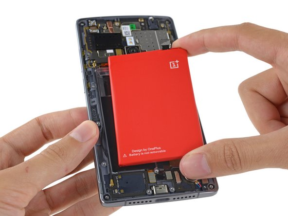 The not-removable battery makes a pretty red target for our grabby teardown hands.