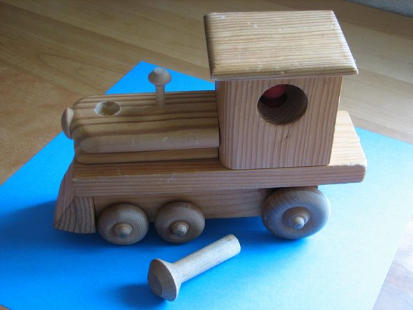 Repairing a Wooden Steam Locomotive Toy
