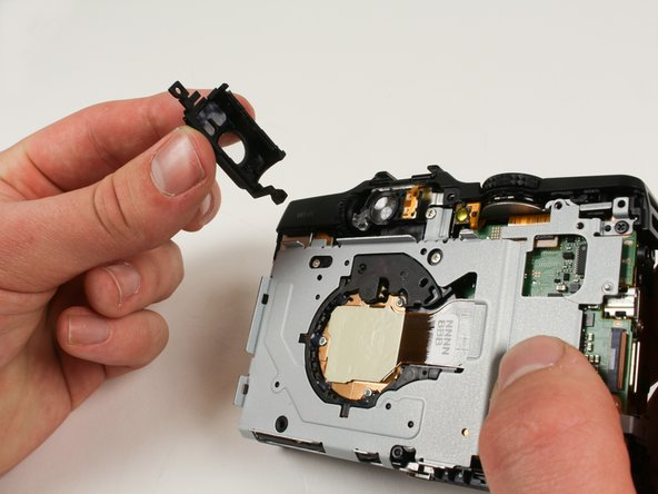 Remove the rear viewfinder casing by firmly gripping it and pulling it out bottom first.