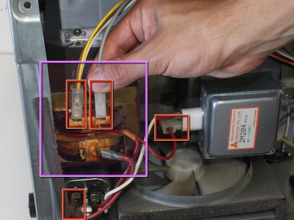 Locate and unhook all wires connecting the transformer to the rest of the microwave.