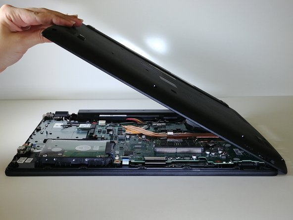 Close the display down once more, and flip the laptop upside down, with the hinge facing away from you.