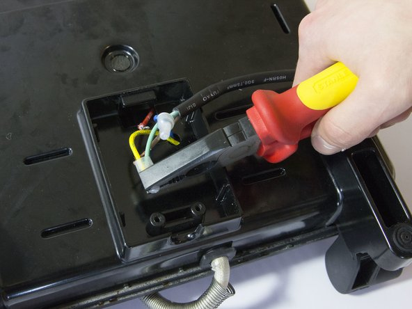 Loosen the wire connectors by gently squeezing them with the pliers.
