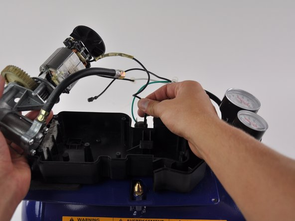 Set the pump/motor assembly on your work place next to the compressor.