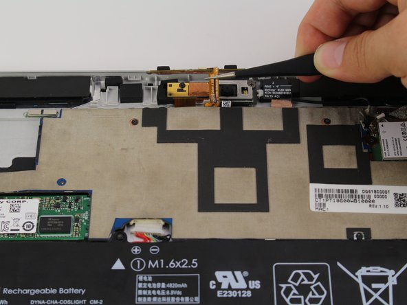Use a pair of tweezers to remove the flex cable on the top of the camera.