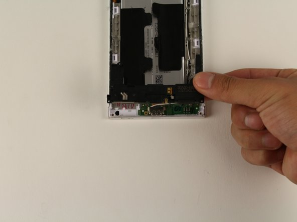 Once the speaker is slightly lifted, use your hands to remove the piece from the device.