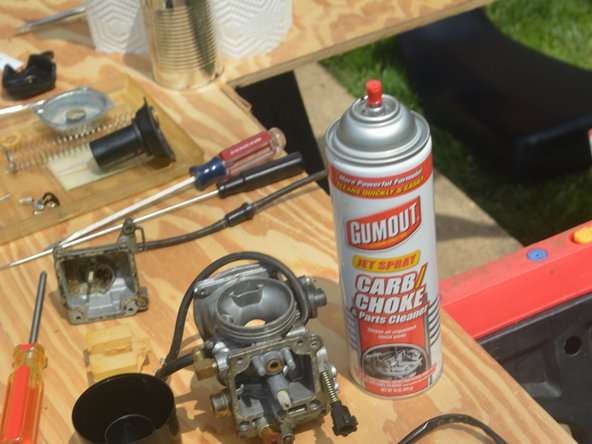 Image 1/2: Be careful not to get carburetor cleaner on your skin or eyes or breathe it in.