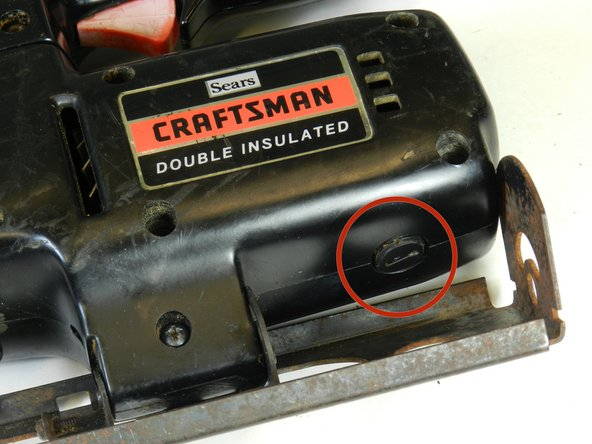 Using a flathead screwdriver, remove the brush caps on the outer casing of the saw near the motor.