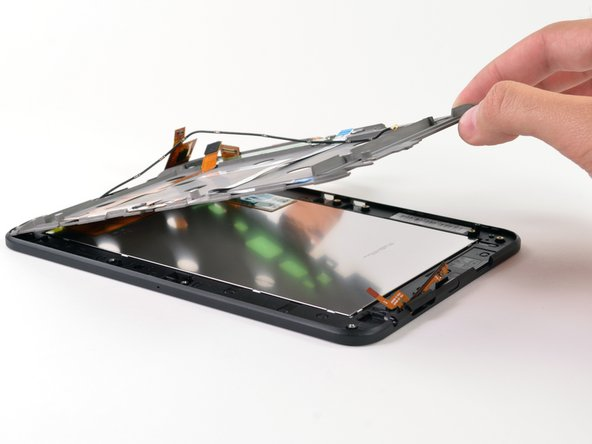 Once the battery and the motherboard have been removed, the inner framework can easily be lifted up off the LCD assembly.