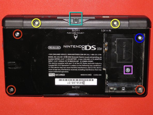 Remove the following 7 screws securing the lower case to the DS Lite: